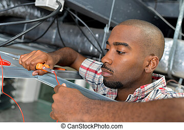 Electrician testing cable