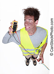 electrician under shock holding tester