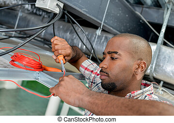 Electrician using cable cutters