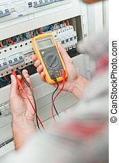 Electrician using multi meter