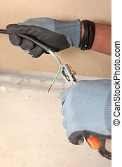Electrician using wire clippers