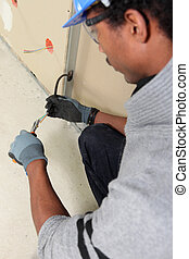 Electrician using wire strippers