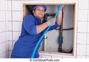 Electrician wiring a bathroom