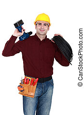 Electrician with a cordless drill