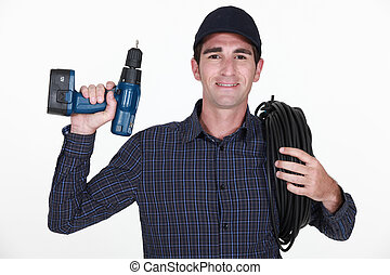 Electrician with a drill