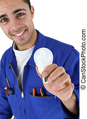 Electrician with a light bulb