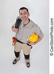 Electrician with a reel of cable