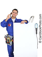 Electrician with a telephone and a board left blank for your message