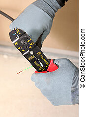 Electrician with a wire cutter