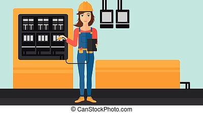 Electrician with electrical equipment. - A woman in helmet...