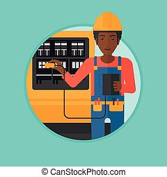 Electrician with electrical equipment. - An african-american...