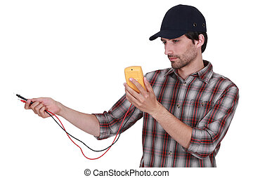 Electrician with multimeter