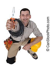 Electrician with pliers