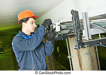 electrician worker at cabling
