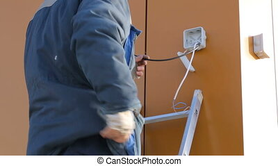 Electrician working at building site
