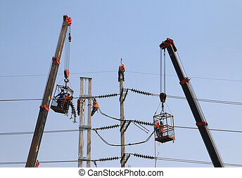 Electrician working at height by connect a high voltage wire...