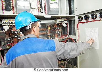 Electrician working at power line box
