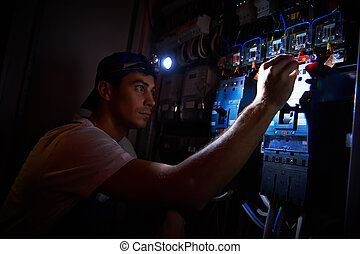 electrician working during damage - electrician worker...