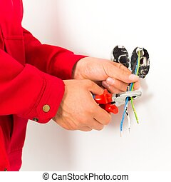 Electrician Working - Electrician working with wires, ...