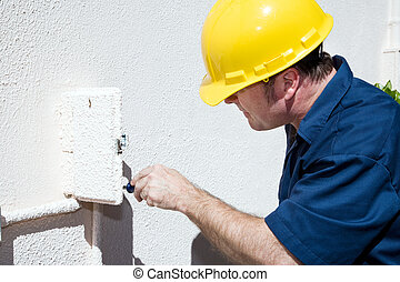 Electrician Working in Electrical Box - Electrician doing...