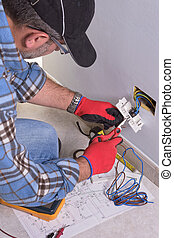 Electrician working in the electrical plant. - Electrician...