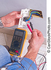 Electrician working in the electrical plant. - Electrician's...