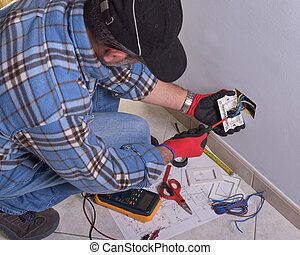 Electrician working in the electrical plant. - The...