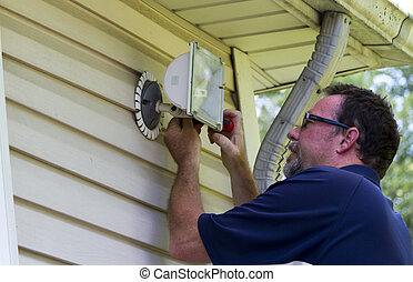 Electrician Working On A Outside Light