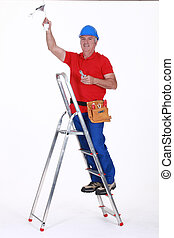 Electrician working on ceiling
