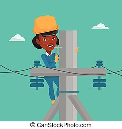 Electrician working on electric power pole. - An african...