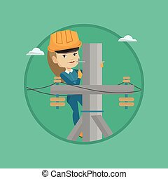 Electrician working on electric power pole. Electrician at...