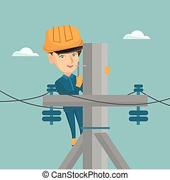 Electrician working on electric power pole. - Young...