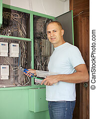 electrician works with electric