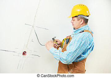 Electricians at cable wiring work