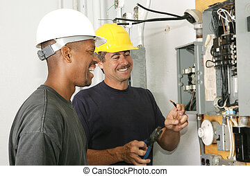Electricians Enjoy Their Job - Two electricians working on ...