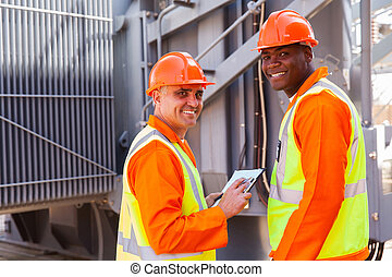 electricians looking back in electrical substation
