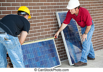 Electricians Measure Solar Panels - Electricians measuring...