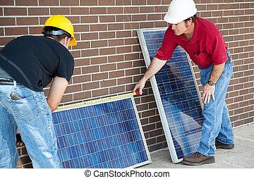 Electricians Measure Solar Panels - Electricians measuring...