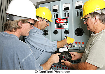 Electricians on High Voltage - Group of electricians using...