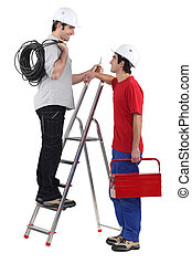 Electricians on white background