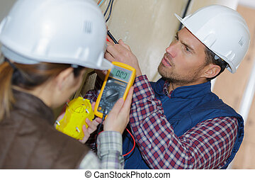 electricians taking measurements