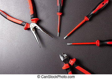 Electrician's tools screwdrivers, nippers, pliers. Electro-insulated tool for working with electricity up to 1000 volts.