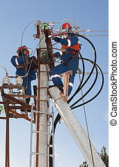 Electricians troubleshoot on power lines