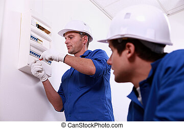 Electricians working
