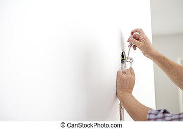 electricista, verificar, el, presencia, de, corriente eléctrica, en, un, nuevamente, installed, alambre