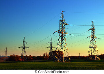 electricity cable communication towers - sunset landscape...