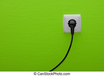 Electricity - Electric outlet on green wall with cable ...
