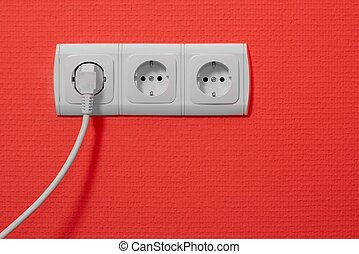 Electricity - Electric outlets on red wall