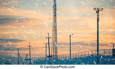 electricity lines under falling snow - electricity lines at...