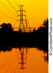 Electricity Pillars against a colorful yellow sunset